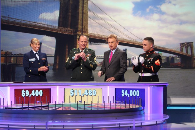 From left, Coast Guard Petty Officer 3rd Class Amber Barrick of St. Petersburg, Fla., Sgt. 1st Class David Kienzl, of Fort Huachuca, Ariz., and Cpl. Travis Tabor of Camp Pendleton, Calif., compete for cash and prizes Oct. 16 in Sony Studios, Los Angeles, Calif. The show aired Tuesday during 'Heroes Week,' a salute to the military.