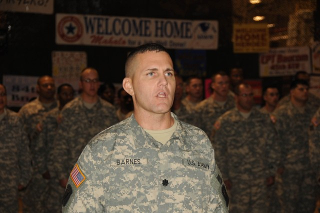Lt. Col. Brent Barnes sings the Army Song during the 45th Sustainment Brigade redeployment ceremony, Dec. 9, at the Wheeler Army Airfield multiple deployment facility.