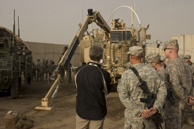 Army Secretary John McHugh meets with Soldiers of Task Force 296, 3rd Stryker Brigade Combat Team, 2nd Infantry Division, as they demonstrate their vehicle capabilities during a visit to Forward Operating Base Warhorse in Diyala, Iraq, Dec. 18, 2009.