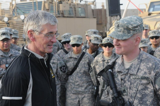 Army Secretary John McHugh speaks with California native Staff Sgt. Nathaniel Cummings of Charlie Company, 296th Brigade Support Battalion, 3rd Stryker Brigade Combat Team, 2nd Infantry Division, about his goals to continue taking care of the Soldiers at Forward Operating Base Warhorse, Diyala, Iraq, Dec. 18, 2009.