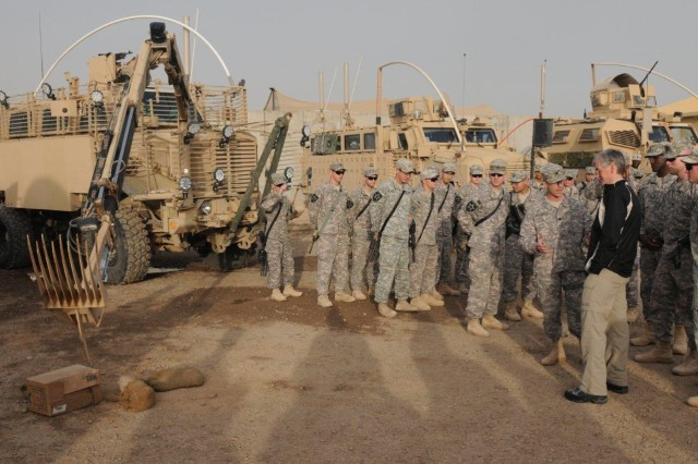 Lt. Col. H. Hayden Hungerford, commander of 296th Brigade Support Battalion, 3rd Stryker Brigade Combat Team, 2nd Infantry Division, discusses the ordnance removal capability of the Engineer Buffalo Mine Protected vehicle with Secretary of the Army John McHugh, at Forward Operating Base Warhorse, Dec. 18, 2009.