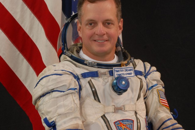 U.S. Army Soldier and NASA astronaut Col. Timothy J. Creamer, Expedition 22/23 flight engineer, attired in a Russian Sokol launch and entry suit, takes a break from training in Star City, Russia, to pose for a portrait.