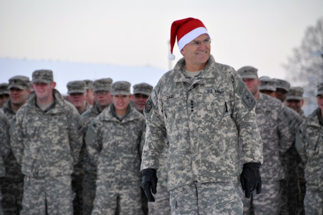 WIESBADEN ARMY AIRFIELD, Germany-Army Chief of Staff Gen. George W. Casey Jr., visits with 1st Armored Division troops on Minue Field Dec. 21 to encourage them to accomplish their mission while in Iraq in 2010.