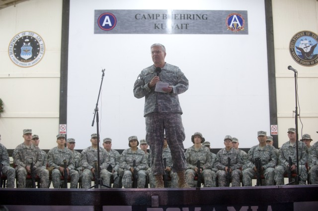 Chief of Staff of the Army Gen. George W. Casey Jr. addresses hundreds of Soldiers that are preparing to deploy to Iraq during an around the world troop visit at Camp Buehring, Kuwait, Dec. 18, 2009. Casey shared his perspective on the state of the Army and thanked the Soldiers for their service.