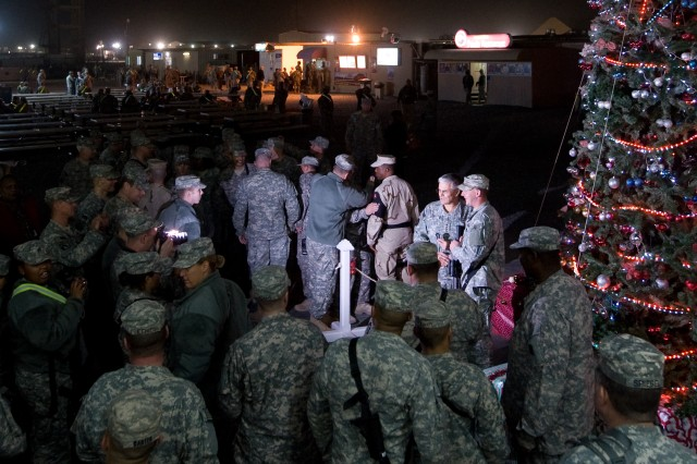 Chief of Staff of the Army Gen. George W. Casey Jr. visits and takes photos with Soldiers at Camp Buehring, Kuwait, Dec. 18, 2009. Most of the Soldiers at Buehring are en route to be deployed in Iraq.