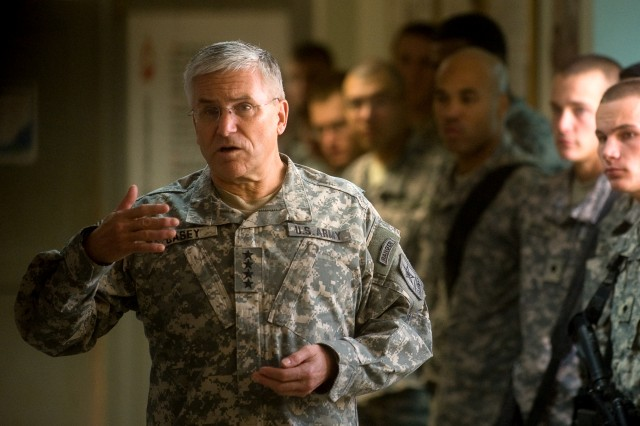 Chief of Staff of the Army Gen. George W. Casey Jr. answers questions from Soldiers with the 194th Engineer Brigade at Balad, Iraq, Dec. 20, 2009.  Casey is in Iraq to visit Soldiers and thank them for their service.