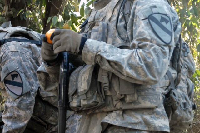 BAGHDAD - St. Mary's County, Md. native, Cpl. Timothy Bennett, a team leader assigned to the 1st Squadron, 7th Cavalry Regiment, 1st Brigade Combat Team, 1st Cavalry Division, enjoys an orange while on patrol outside Joint Security Station Istiqlal, Dec. 11.