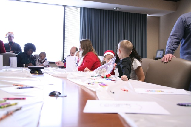 Children of USAMDC/ARSTRAT employees color a variety of holiday themed pictures along with their parents.