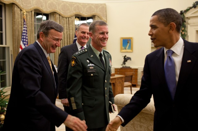 President Barack Obama shares a lighter moment with, from left, Karl Eikenberry, U.S. Ambassador to Afghanistan, National Security Advisor Gen. James Jones, and Gen. Stanley McChrystal, commander of U.S. Forces in Afghanistan in the Oval Office, Dec. 7, 2009. Obama signed the 2010 Department of Defense Appropriations Act into law Dec. 19, after the Senate approved it, providing the funds needed for military programs and wartime operations in Afghanistan and Iraq in the coming months.