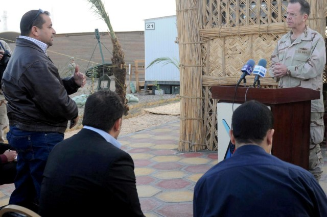 A local journalist asks Adm. Michael G. Mullen, chairman of the Joint Chiefs of Staff, a question during a press conference for local media Dec. 18 at Contingency Operating Location Adder, Iraq.