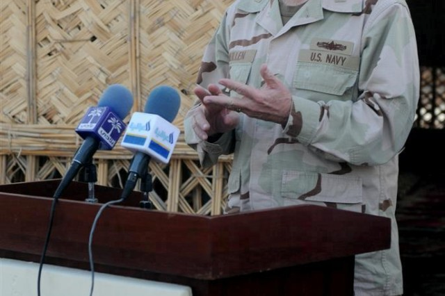 Adm. Michael G. Mullen, chairman of the Joint Chiefs of Staff, answers a question during a press conference for local media Dec. 18 at Contingency Operating Location Adder, Iraq.