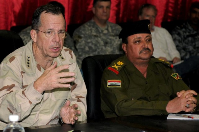 Adm. Michael G. Mullen, chairman of the Joint Chiefs of Staff, speaks during a meeting with local dignitaries Dec. 18 at Contingency Operating Location Adder, Iraq.