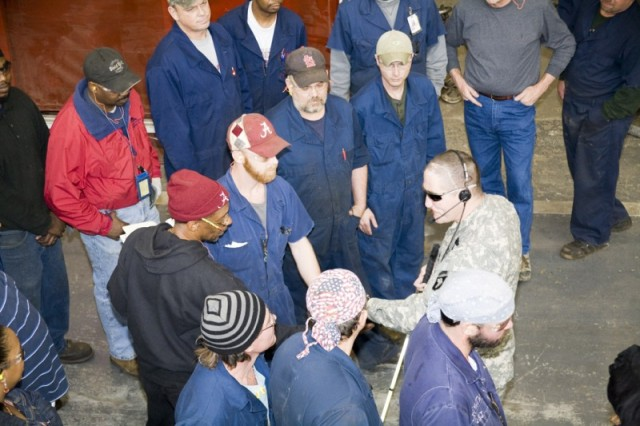 Mechanics and welders in Anniston Army Depot's Nichols Industrial Complex flock to Master Sgt. Jeffrey Mittman.