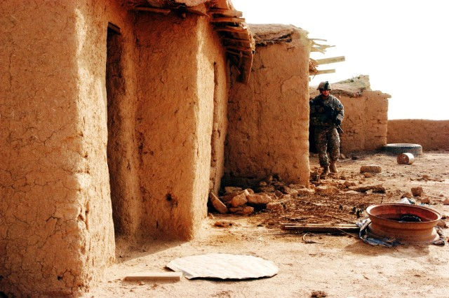 CONTINGENCY OPERATING LOCATION Q-WEST, Iraq - Sgt. Patrick A. Martin, a force protection company truck commander from Southaven, Miss., reconnoiters buildings in an abandoned village near Contingency Operating Location Q-West during a presence patrol, Dec. 15. Martin serves with the Mississippi Army National Guard's A Company, 2nd Battalion, 198th Combined Arms, 155th Brigade Combat Team, headquartered in Hernando, Miss. During the patrol, the Soldiers demonstrated their strategies for combating complacency, such as practicing battle drills, alternating routes and meeting with local Iraqis.