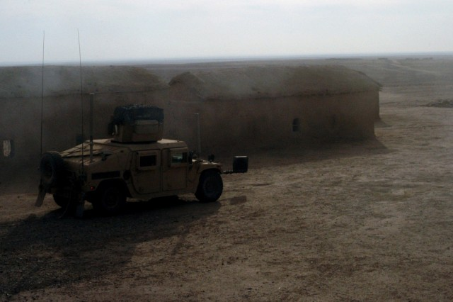 CONTINGENCY OPERATING LOCATION Q-WEST, Iraq - A Mine-Resistant, Ambush-Protected gun truck of the force protection company conducts a presence patrol through an abandoned village near Contingency Operating Location Q-West, Dec. 15. The Soldiers serve with the Mississippi Army National Guard's A Company, 2nd Battalion, 198th Combined Arms, 155th Brigade Combat Team, headquartered in Hernando, Miss. During the patrol, the Soldiers demonstrated their strategies for combating complacency, such as practicing battle drills, alternating routes and meeting with local Iraqis.