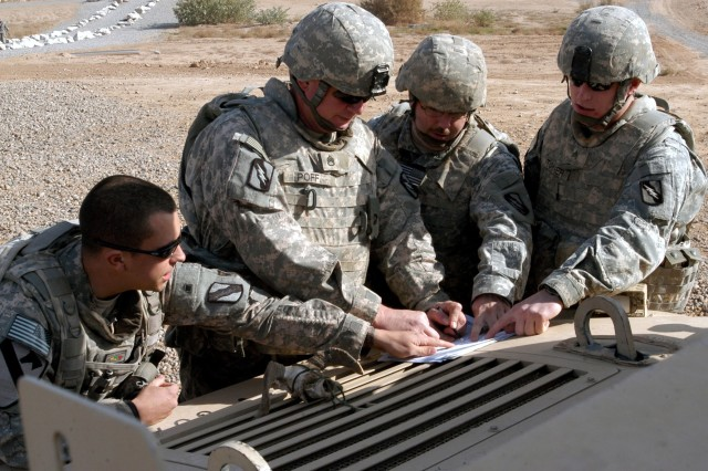 CONTINGENCY OPERATING LOCATION Q-WEST, Iraq - Squad and team leaders of the quick reaction force confer before a presence patrol at the Base Defense Operations Center, Contingency Operating Location Q-West, Dec. 15. The Soldiers serve with A Company, 2nd Battalion, 198th Combined Arms, 155th Brigade Combat Team, headquartered in Hernando, Miss. Pictured are Sgt. Patrick A. Martin (left), a truck commander from Southaven, Miss., Staff Sgt. Stephen S. Poff, squad leader and truck commander from Ashland, Miss., Sgt. Jeremy L. Sapp, a truck commander from Blue Springs, Miss., and Sgt. Dustin O. Turner, a truck commander from Lake Cormorant, Miss.