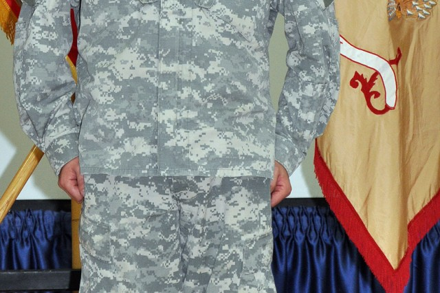 Staff Sgt. Justin Taylor, a Lancaster, Pa., native and assistant platoon sergeant for the 733rd Trans. Co., 395th CSSB stationed in Reading, Pa., stands at attention before receiving the Purple Heart here Dec. 17 for an injury sustained in a roadside bomb attack Aug. 30. (U.S. Army photo by Sgt. Matthew C. Cooley, 15th Sustainment Brigade public affairs)