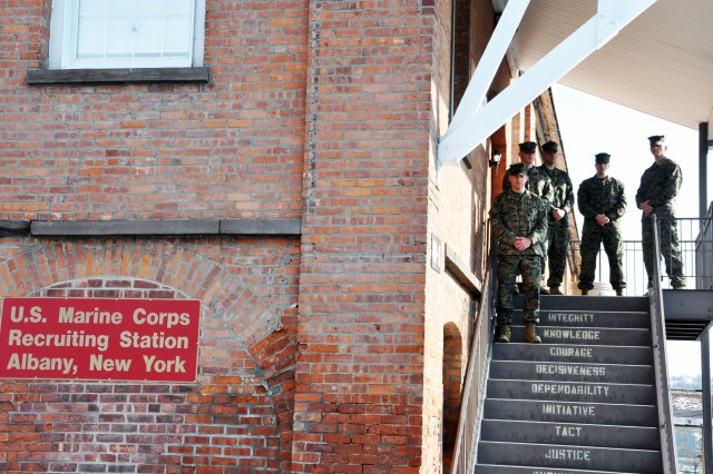 USMC Maj. Daniel Whitley, Capt. Brent Rider, Cpl. Joshua Decker, Sgt. Joseph DiGirolamo, and Capt. Paul Gates stand at the entrance to the Albany USMC Recruiting Station at the Watervliet Arsenal.  Each step one takes reminds all about the leadership values of the United States Marine Corps.  Whitley is the commander.