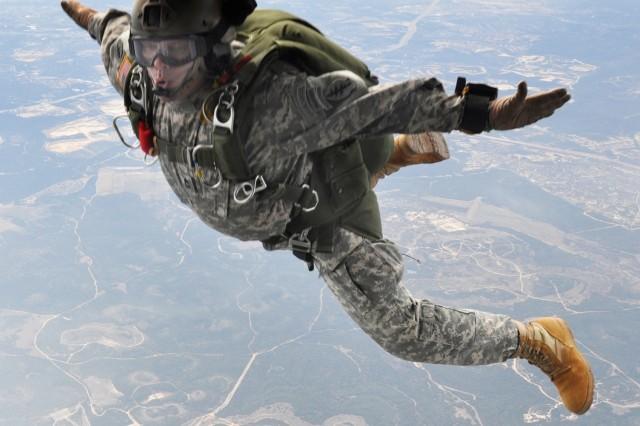 "Sgt. 1st Class John McIntosh, a member of the ""high-altitude low opening"" or HALO team that does freefall insertions, jumps from a CH-47D Chinook at 12,500 feet as part of a change of command ceremony for his unit, Charlie Company, 5th Battalion, 19th Special Forces Group (Airborne)."