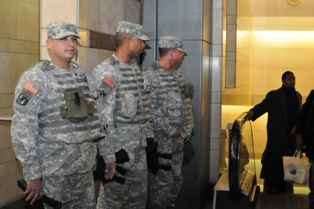 New York Army National Guard Soldiers (from left) Sgt. Edgar Rosales,  Sgt. Benedict Taylor, and Sgt. Michael Decaprio monitor traffic at a New York City subway station on Christmas Eve, Dec. 24. The three Soldiers, all from New York City, are part of the New York National Guard's Joint Task Force Empire Shield, which provides a full-time security presence in New York City.  The 200+ Soldier and Airman task force operates at the direction of New York Governor David Paterson and augments police and other civilian security services in the metropolitan area. Rosales is a member of the 1569th Transportation Co., Taylor belongs to the 642nd Aviation Support  Battalion, and Decaprio is a member of the 727th Law and Order Detachment  New York has had National Guard members on duty full-time since the attacks of Sept. 11, 2001.
