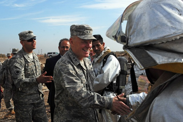 Multi-National Corps- Iraq Deputy Commanding General Major General James P. Hunt greets firefighters from Baghdad International Airport during a training excercise held Dec. 16.