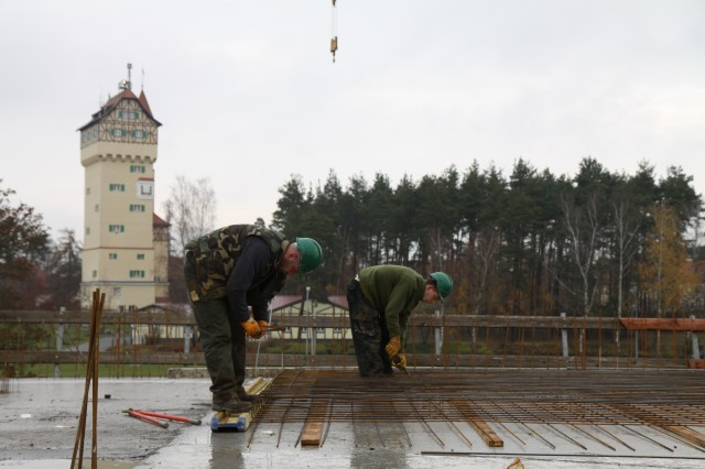 Contractors continue construction on the $24 million Army Lodging facility for the U.S. Army Garrison Grafenwoehr in Germany, which is being managed by the U.S. Army Corps of Engineers Europe District. The facility is expected to have roughly 136 units that will offer Soliders standard rooms, extended-stay rooms and family suites. Construction is scheduled to be complete in 2011. The lodge construction site was just one of the areas toured by Engineering News Record reporter Tom Sawyer during his visit with the district. (U.S. Army Corps of Engineers photo by Justin Ward)