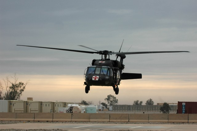 A UH-60A Blackhawk helicopter operated by MEDEVAC Soldiers of Company C, 3-25th General Support Aviation Battalion, Task Force Hammerhead, takeoff from a Combat Support Hospital located at Contingency Operating Base Speicher, near Tikrit, Iraq, Dec. 9. Company C is the primary MEDEVAC company operating in United States Division-North. (Photo by: Staff Sgt. Mike Alberts  25th Combat Aviation Brigade Public Affairs)