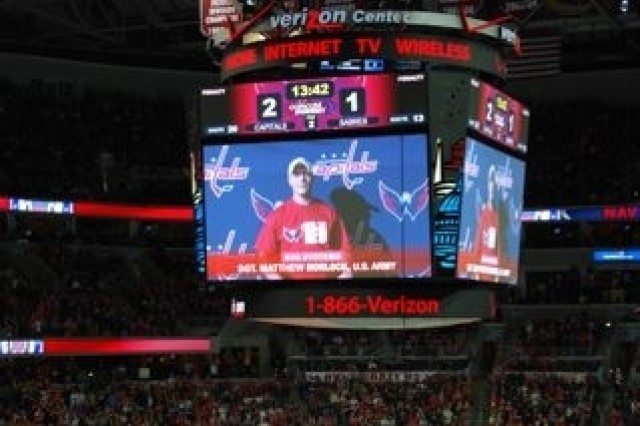 Sgt. Matthew Morlock, the Military District of Washington NCO of the Year, is shown on the jumbotron during Army Appreciation Night at the Washington Capitals hockey game Dec. 23.