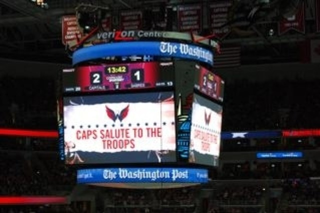A message supporting the troops is displayed on the jumbotron during Army Appreciation Night at the Washington Capitals hockey game Dec. 23.