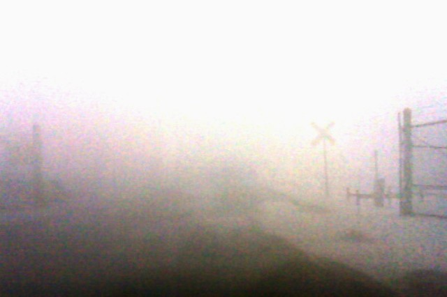 White-out conditions brought about by strong winds and blowing snow forced many drivers to slow to a crawl as an early winter storm hit Fort Sill on Christmas Eve. Here, the driver can barely make out objects just a few feet from her car.