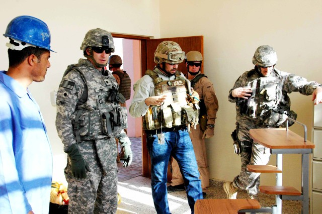 Paul Ijames, U.S. Army Corps of Engineers project engineer (center) conducts the final inspection of a classroom before turning the completed Al-Mazraa Elementary School over. He is joined by Lt. Col. Richard Pratt, second from left, deputy commander, and Command Sgt. Maj. Gregg Phillips, right, both from the Gulf Region District.