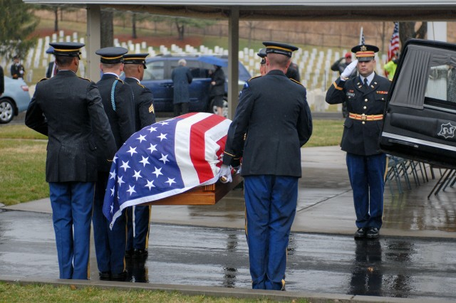 Members of the New York Military Forces Honor Guard move the casket containing the remains of Army Sgt. Dougall Espey from a hearse during his burial in Woodlawn National Cemetery on April 3. Espey was killed in Korea in November 1950 and his remains were identified in 2008. He was buried on what would have been his 80th birthday.""