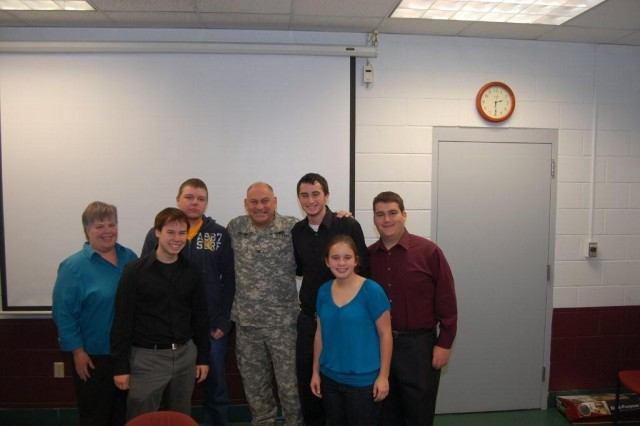 Col. Craig S. Cotter, commander Rock Island Arsenal Joint Manufacturing and Technology Center, poses with local high school studnets who participated in the first RIA-JMTC Logistics Academy.