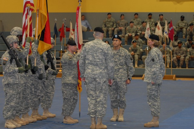 Command Sgt. Maj. James E. Spencer (left), command sergeant major, 16th Sustainment Brigade, accepts the brigade colors from Col. Keith Sledd (facing away), incoming commander, 16th Sust. Bde., during a change of command ceremony at the Freedom Fitness Facility, Bamberg, Germany, Dec. 16. Sledd takes over for Col. Martin B. Pitts (second from right), outgoing commander, 16th Sust. Bde. Pitts led the 16th Sust. Bde., the only sustainment brigade in Europe, from activation July 16, 2007, through a 15-month deployment to northern Iraq, and through redeployment and reintegration.