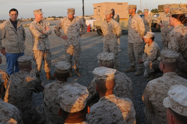 """General James F. Amos (Standing second from left), Assistant Commandant of the Marine Corps, and Darrell Issa (Standing left), Congressman for the 49th Congressional District, meet with Marines of the MARCENT Coordination Element Kuwait, during a Dec. 22 visit to Kuwaiti Naval Base, Kuwait.  The Marines sustain operations involving the movement of equipment from Iraq back to the United States. The general used the opportunity to express his appreciation for their service. """"All I can say is I am proud of them,"""" said Amos. """"Every one of them signed up and they didn't have to. I want to wish them all a Merry Christmas and a happy new year."""""""