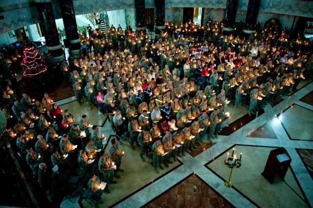 Service members and civilians celebrate Christmas Eve Candlelight Service at Al Faw Palace in Baghdad, Iraq, Dec. 24.