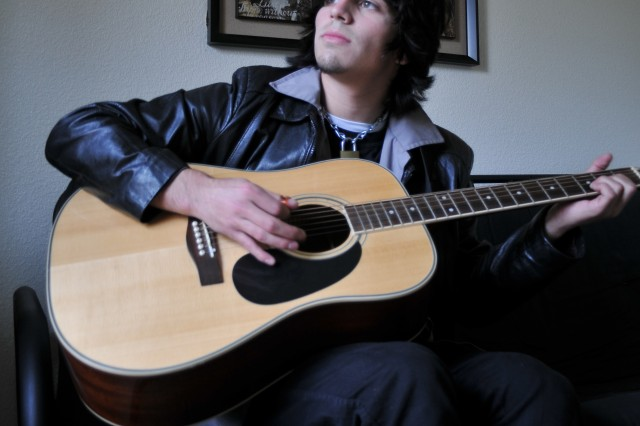"""PRESIDIO OF MONTEREY, Calif. Aca,!"""" Brett Freshour has been working on his music since the age of 10. Aca,!A""""He was always self-motivated and really independent about his art,Aca,!A? said mother Annette Stewart."""
