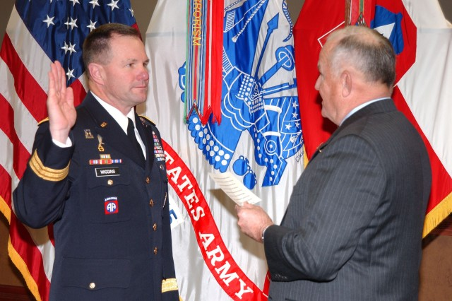 FORT SAM HOUSTON, Texas - Retired Lt. Gen. Freddy McFarren (right), former commanding general, U.S. Fifth Army, administers the oath of office to Maj. Gen. Perry Wiggins, deputy commanding general, U.S. Army North, during Wiggins' promotion ceremony Dec. 28 inside Army North's historic headquarters at the Quadrangle.  Wiggins has served as ARNORTH's deputy commanding general since April 27. He previously served as the acting commanding general of the 1st Infantry Division at Fort Riley, Kan.