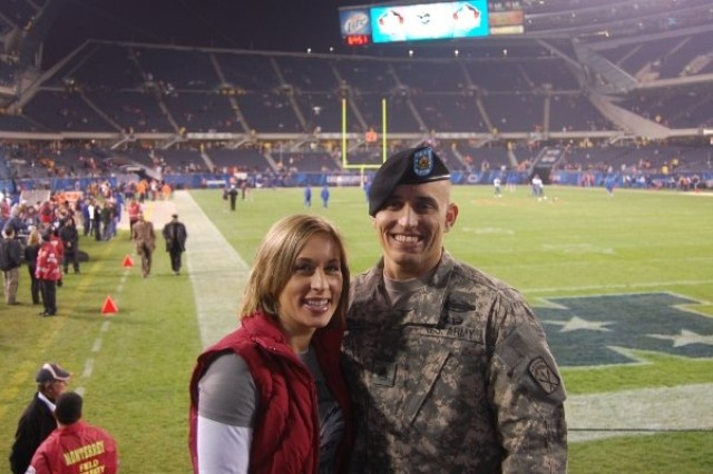 "Staff Sgt. James Rivera and his wife, Jennifer, pose for a picture at a football game. Rivera said Jennifer is his hero. After being injured in Afghanistan in 2004, he said she made him feel like he had something to live for. ""She has truly saved me,"" he said."