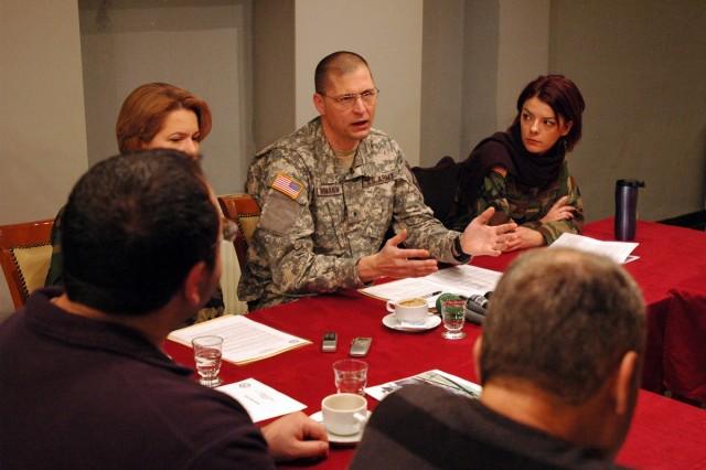 Brig. Gen. Al Dohrmann, Bismarck, N.D., commanding general of Multi-National Task Force-East, answers a question for media in Ferizaj/Urosevac, during a Dec. 30 press coffee.