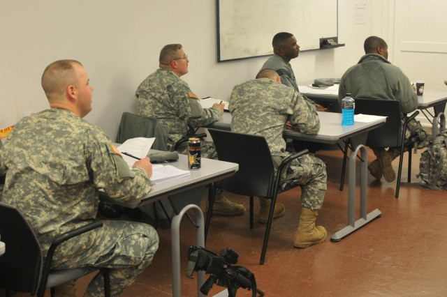 U.S. KFOR Soldiers listen as an instructor gives a lecture on basic law terms and their meanings, during a recent class offered by the Laura Bush Education Center at Camp Bondsteel, KosovoBody