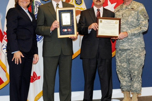 Administrative Assistant to the Secretary of the Army Joyce E. Morrow and Director, Enterprise Task Office, Office of the Chief of Staff of the Army Lt. Gen. Robert E. Durbin Sr., present the Joint Munitions Command's Subordinate Level Organizational Development Award from the 2009 Army Lean Six Sigma Awards Program to Organizational Change Manager and former LSS Deployment Director Walter J. Songaila (second from left),  and Acting LSS Deployment Director Stephen A. Tutt on Nov. 24 at a ceremony held at the Pentagon.