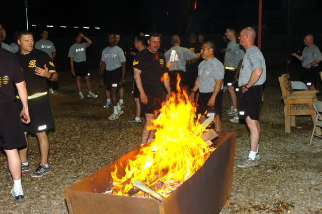 CAMP TAJI, Iraq- A burn barrel provides warmth for senior noncommissioned officers of the 1st Air Cavalry Brigade, 1st Cavalry Division, following a fun run to bring in the New Year, here, Dec. 31. Both sergeants major and first sergeants ran together with potential first sergeants as a way to recognise future leaders.