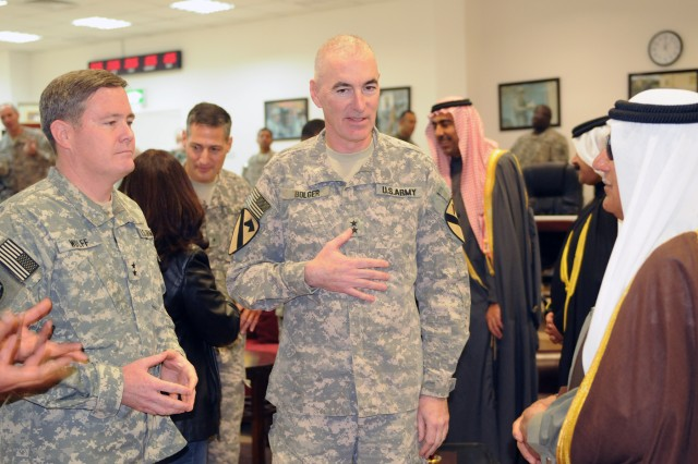 BAGHDAD-Maj. Gen. Terry Wolff (left), commander of the 1st Armored Division and Maj. Gen. Daniel Bolger (center), commander of United States Division-Center and the 1st Cavalry Div., meet with prominent tribal sheikhs from the Baghdad area, Jan. 5. The Iraqi leaders praised the brotherhood and friendship they have cultured with U.S. forces and looked forward to partnering with Wolff for the safety and security of the country.