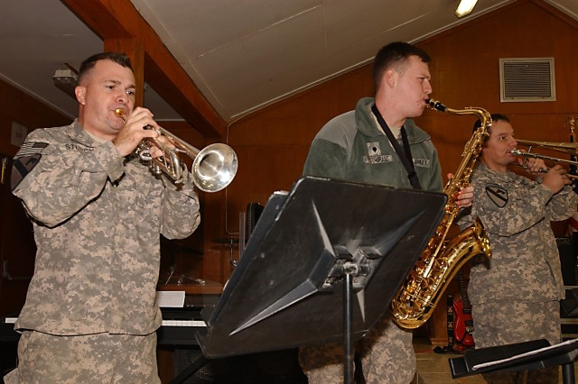 BAGHDAD - Members of the 1st Cavalry Division's rock band horn section perform a Christmas concert, Dec. 22, at the division chapel as a special thanks to the Division Special Troops Battalion for all of the support provided throughout the band's deployment.