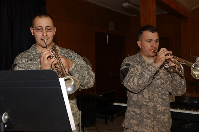 BAGHDAD - Specialists Phil Terrell and David Sturch, trumpet players in the 1st Cavalry Division's rock band, perform in a holiday concert, Dec. 22, day at the division chapel on as a special thanks to the Division Special Troops Battalion for all of the support provided throughout the band's deployment.