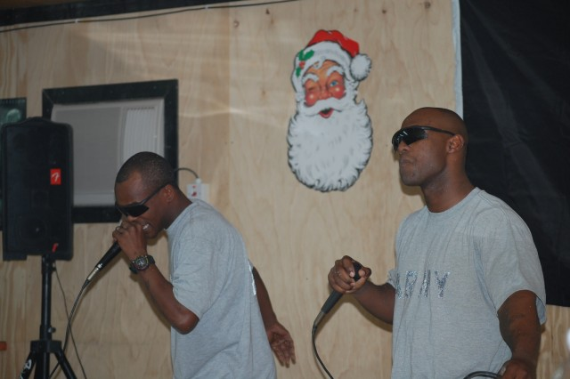 """BAGHDAD - Cpl. Thomas """"Yung Capp"""" Taylor, a human resources specialist from Columbus, Ohio and Bastrop, La. native Sgt. Marchello """"Squeezie"""" Jimerson, a cavalry scout, perform their original song, """"Monster"""", during their Squadron talent show at Joint Security Station Istiqlaal, Dec. 21.  Soldiers from 1st Squadron, 7th Cavalry Regiment, 1st Brigade Combat Team, 1st Cavalry Division showcased their abilities during the """"Istiqlaal's Got Talent"""" show."""