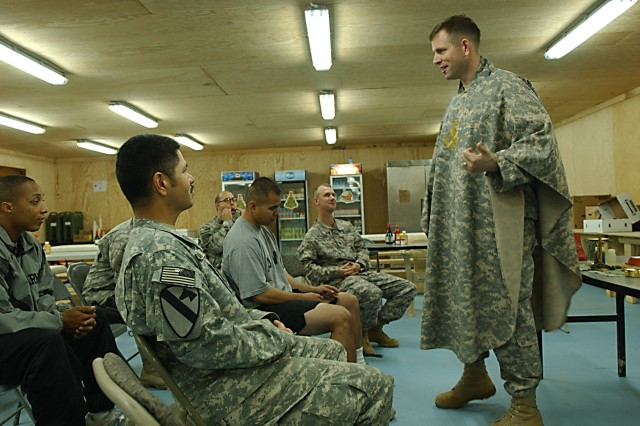 BAGHDAD - 1st Air Cavalry Brigade, 1st Cavalry Division's Chap. (Maj.) Tyson Wood  gives a homily during a Catholic mass Christmas Day to Soldiers of 2nd Battalion, 14th Infantry Regiment, 2nd Brigade Combat Team, 10th Mountain Division, MND-B at Joint Service Station Suj.