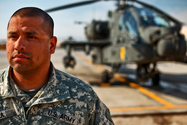 CAMP TAJI, Iraq -Sgt. Nicanor Garcia, from Killeen, Texas, an AH-64D Apache attack helicopter crew chief in Company B, 4th Battalion, 227th Aviation Regiment, 1st Air Cavalry Brigade, 1st Cavalry Division, left his native Panama in 1989 before the invasion by the U.S. Army and didn't return until 20 years later.