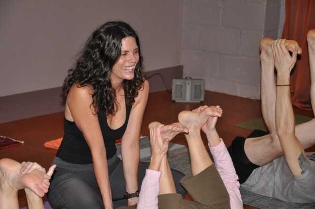 Ginger Doughty instructs a recent yoga class at City Yoga in downtown Columbia, S.C. Doughty works with Soldiers and veterans who have been diagnosed with post-traumatic stress disorder. The Army is increasingly turning to yoga and other alternative treatments to deal with anxiety disorders related to combat. The Soldiers in the photo are not shown to protect their privacy.
